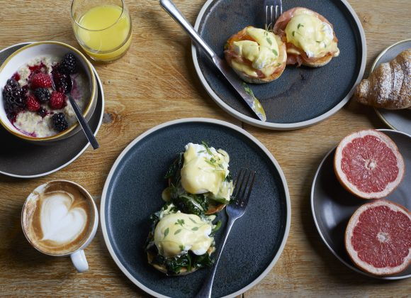 Breakfast of grapefruit, poached eggs and smoke salmon, porridge & berries and croissants at The Archangel, pub and cocktail bar with bedrooms in Frome, Somerset