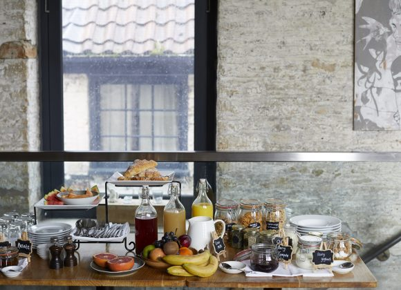 Breakfast bar set up in the restaurant at The Archangel, pub and cocktail bar with bedrooms in Frome, Somerset