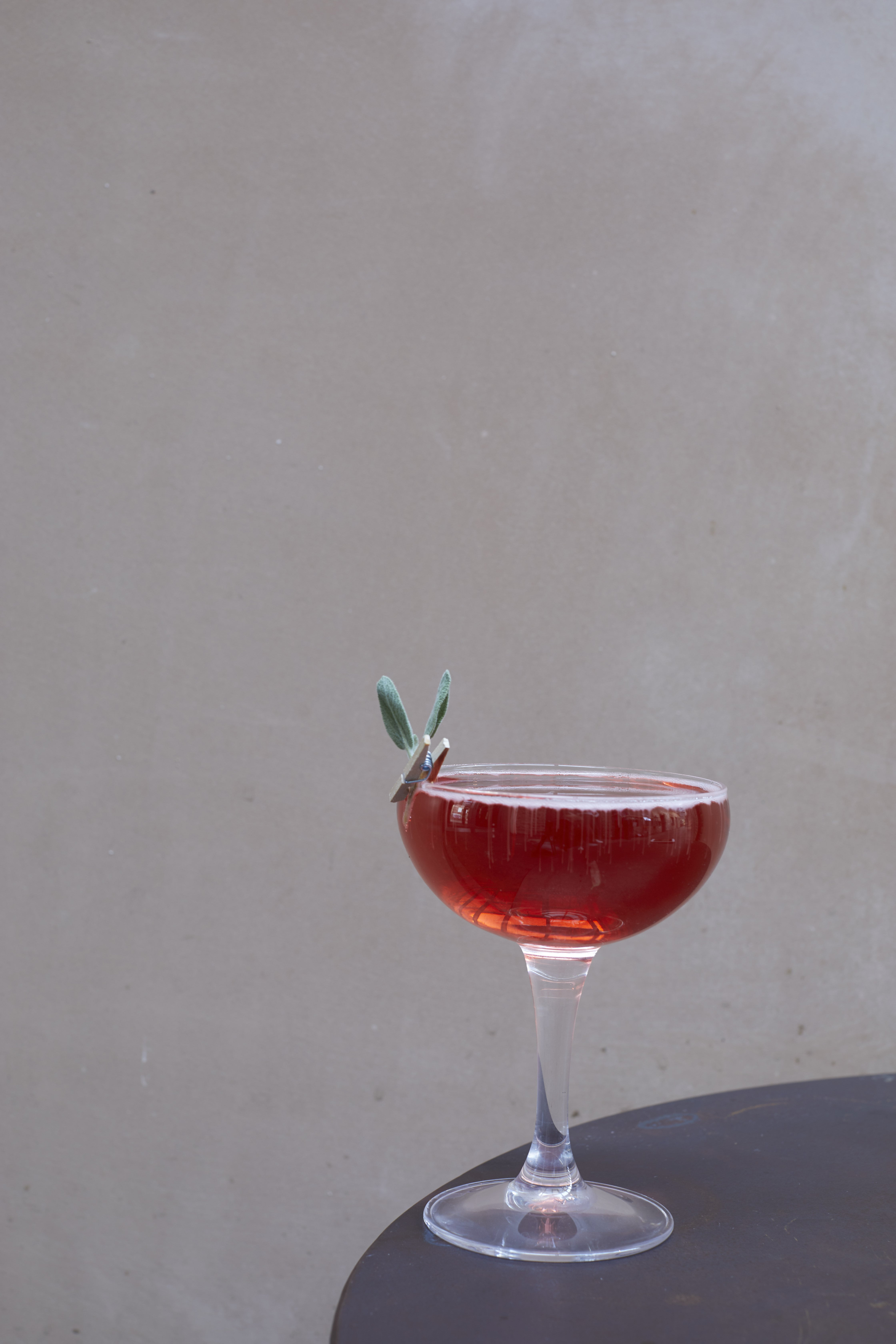 close up of redcocktails with fresh herbs pinned to the glass at The Archangel, pub and cocktail bar with bedrooms in Frome, Somerset
