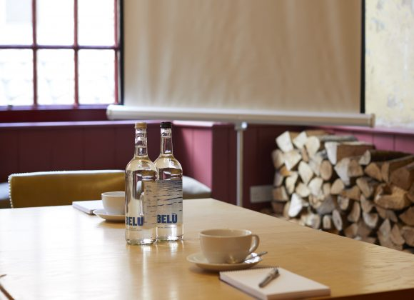 projector screen and table laid for a corporate event at The Archangel, pub and cocktail bar with bedrooms in Frome, Somerset