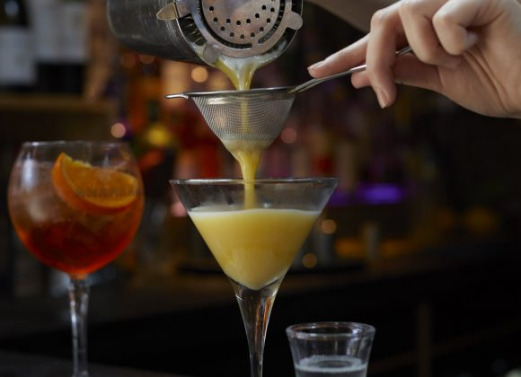 pouring a Pornstar martini at the bar at The Archangel, pub and cocktail bar with bedrooms in Frome, Somerset