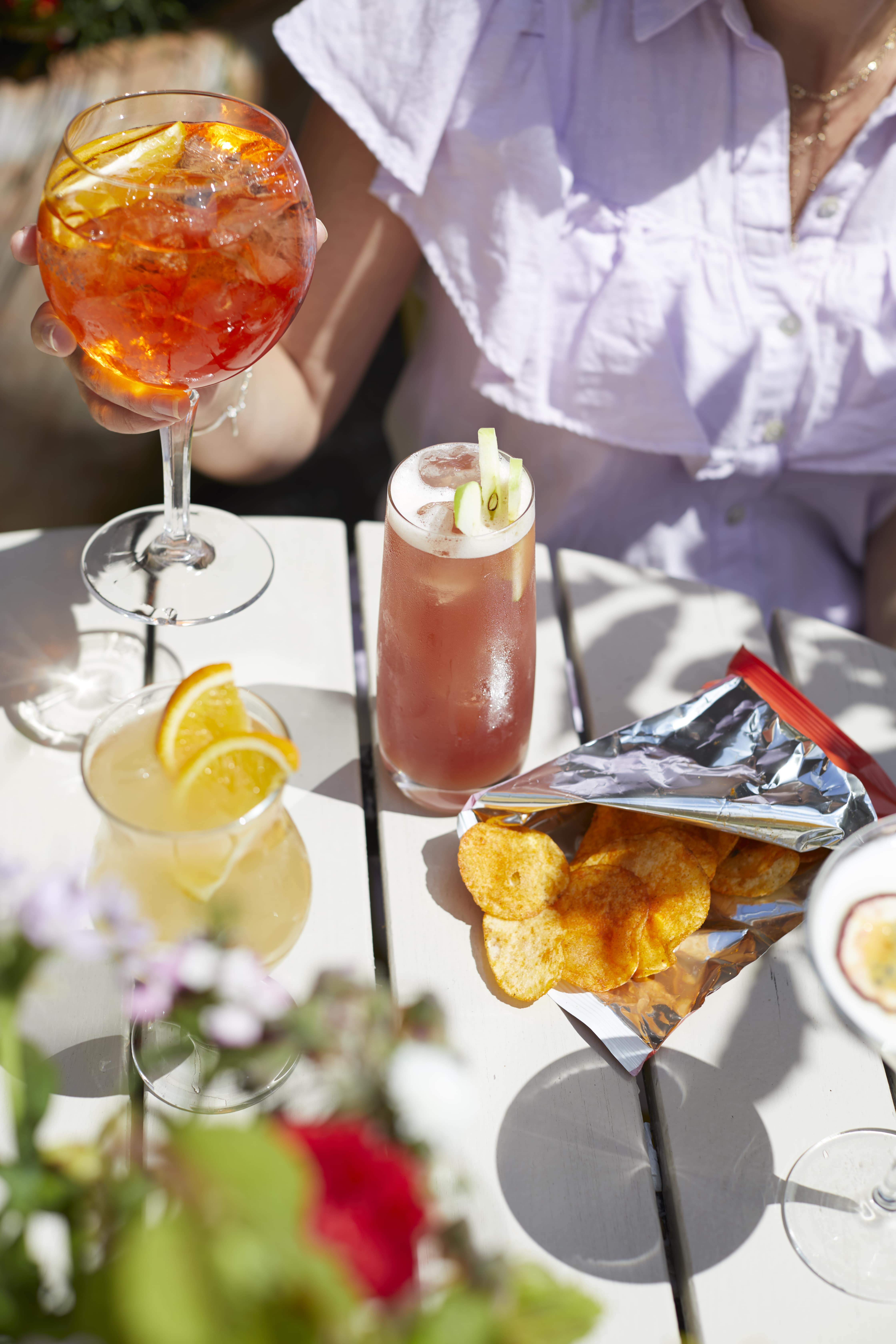 colour cocktails and bar nibbles outdoor in courtyard garden at The Archangel, pub and cocktail bar with bedrooms in Frome, Somerset