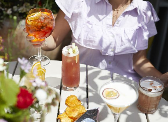 colourful cocktails and bar nibbles in the courtyard garden at The Archangel, pub and cocktail bar with bedrooms in Frome, Somerset